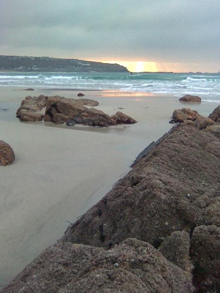 Surfing at Sunset, Whitesand Bay